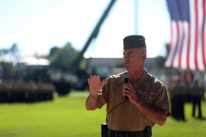 U.S. Marine Brig. Gen. David A Ottignon 1st Marine Logistics Group (1st MLG) speaks to Marines, Sailors, family, and friends who attended during the 1st Marine Logistics Group Change of Command Ceremony aboard Camp Pendleton, Calif., July 24, 2015. The Change of Command for 1st MLG showcased the passing of command from Maj. Gen. Vincent A. Coglinese to Brig. Gen. David a Ottignon. (U.S. Marine Corps photo by Lance Cpl. Lauren Falk/Released)