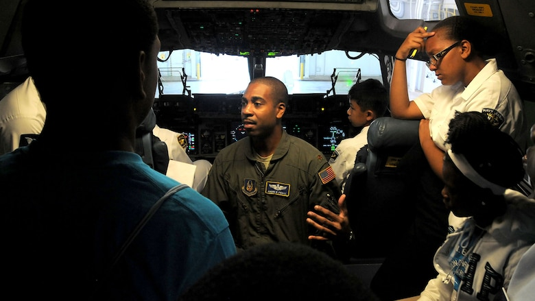 Maj. Andrew Pierce, 89th Airlift Squadron C-17 pilot, shows Dream Flight participants the flightdeck area of a C-17 Globemaster III during the group's visit to the 445th Airlift Wing July 22, 2015. More than 180 students ages 14-18 and their chaperons visited the wing as part of the 16th Annual Delta Airlines sponsored Dream Flight program. (U.S. Air Force photo/Tech. Sgt. Anthony Springer)