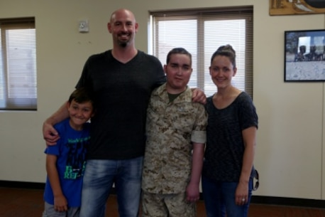 James Gallant, a young man diagnosed with brain cancer, poses for a photo with his family aboard Camp Pendleton, Calif., July 25, 2015. Collaborating with the Make-A-Wish Foundation, 1st Explosive Ordnance Disposal Company, 1st Marine Logistics Group, helped James experience what being an EOD technician is like by giving him a tour through their library of ordnance and EOD tools, teaching him to operate the TALON bomb disposing robot and presenting him with his own desert utilities and EOD badge.