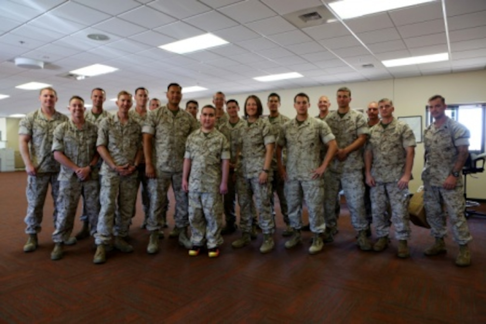 James Gallant, a young man diagnosed with brain cancer, poses for a photo with Marines of 1st Explosive Ordnance Disposal Company, 1st Marine Logistics Group, aboard Camp Pendleton, Calif., July 25, 2015. Collaborating with the Make-A-Wish Foundation, 1st EOD helped James experience what being an EOD technician is like by giving him a tour through their library of ordnance and EOD tools, teaching him to operate the TALON bomb disposing robot and presenting him with his own desert utilities and EOD badge.