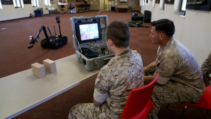 James Gallant, a young man diagnosed with brain cancer, operates the TALON Explosive Ordnance Disposal robot with Marines of 1st EOD Company, 1st Marine Logistics Group, aboard Camp Pendleton, Calif., July 25, 2015. Collaborating with the Make-A-Wish Foundation, 1st EOD helped James experience what being an EOD technician is like by giving him a tour through their library of ordnance and EOD tools, teaching him to operate the TALON bomb disposing robot and presenting him with his own desert utilities and EOD badge.