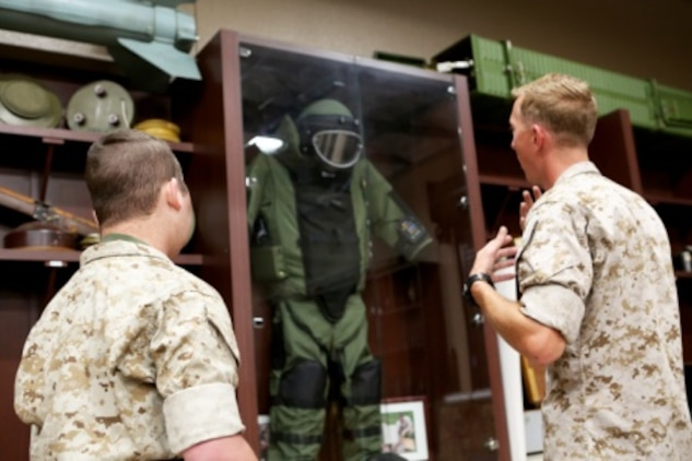 James Gallant, a young man diagnosed with brain cancer, tours the Explosive Ordnance Disposal library with Marines of 1st EOD Company, 1st Marine Logistics Group, aboard Camp Pendleton, Calif., July 25, 2015. Collaborating with the Make-A-Wish Foundation, 1st EOD helped James experience what being an EOD technician is like by giving him a tour through their library of ordnance and EOD tools, teaching him to operate the TALON bomb disposing robot and presenting him with his own desert utilities and EOD badge.