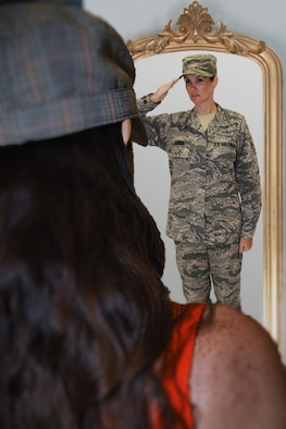 Senior Airman Christine Fannin, 927th Force Support Squadron, reflects on her life after leaving the Active Duty Air Force component. Throughout her 12-year break in service, Fannin always felt that something was missing in her life, she realized it was her uniform. Today, she again serves her country, assigned to the 927th Air Refueling Wing, MacDill Air Force Base, Fla. (U.S. Air Force photo illustration by Staff Sgt. Adam C. Borgman)