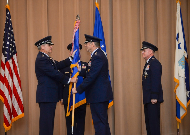 Gen. Robin Rand accepts the Air Force Global Strike Command flag from Air Force Chief of Staff Gen. Mark A. Welsh III during a change of command ceremony at Barksdale Air Force Base, La., July 28, 2015. The Air Force elevated AFGSC to a four-star major command to provide its nuclear deterrence and global strike missions with the highest level of leadership oversight similar to the service's other core operational missions. (U.S. Air Force photo/Senior Airman Jannelle Dickey)