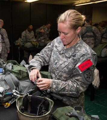 U.S. Army Sgt. Maj. Kristie Brady prepares for an airborne jump with the Joint Communications Support Element, an airborne communications unit headquartered at MacDill Air Force Base, Fla. Brady, who serves as a jumpmaster within JCSE, was recently selected as the first female command sergeant major of another airborne communications unit -- the 112th Special Operations Signal Battalion headquartered at Fort Bragg, N.C. Joint Communications Support Element photo by Rick Maupin