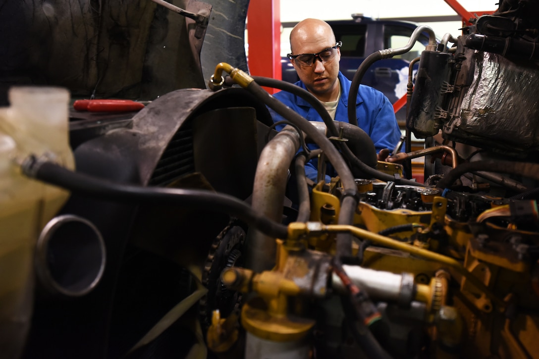 Staff Sgt. Rock Conley, 341st Logistics Readiness Squadron truck and tractor shop vehicle mechanic, works on a maintenance van engine July 27, 2015, at Malmstrom Air Force Base, Mont. The shop upholds a 96.8 percent of maintenance vans available to do the base mission. (U.S. Air Force photo/Chris Willis)
