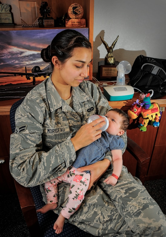 U.S. Air Force Airman 1st Class Cheyenne Morigeau bottle feeds her daughter at Davis-Monthan Air Force Base Ariz., July 21, 2015. TRICARE is now covering breast pumps for expecting mothers as well as reimbursing moms who purchased one after Dec. 19, 2014. Expecting mothers are authorized one standard or electric breast pump per birth. Hospital grade breast pumps are available for mothers who have a medical reason requiring one. (U.S. Air Force photo by Staff Sgt. Angela Ruiz/ Released)