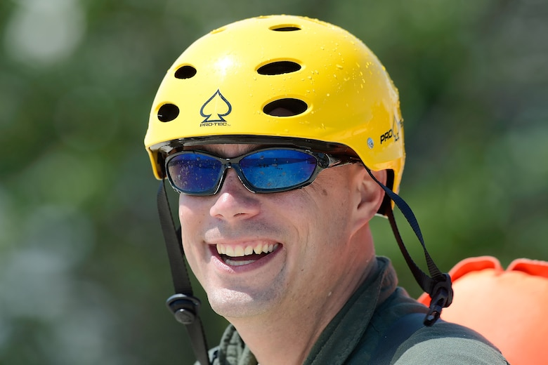 Technical Sgt. Jason Massey, 3d Airlift Squadron C-17A Globemaster III loadmaster, smiles after successfully completing a water survival refresher training event in the Delaware Bay in a class conducted by the 436th Operations Support Squadron Survival, Evasion, Resistance and Escape Operations, July 17, 2015, near Dover Air Force Base, Del.  The C-5M Super Galaxy and C-17A Globemaster III aircrew of the 436th Airlift Wing and the 512th Airlift Wing completed the training which is required every three years. (U.S. Air Force photo/Greg L. Davis)