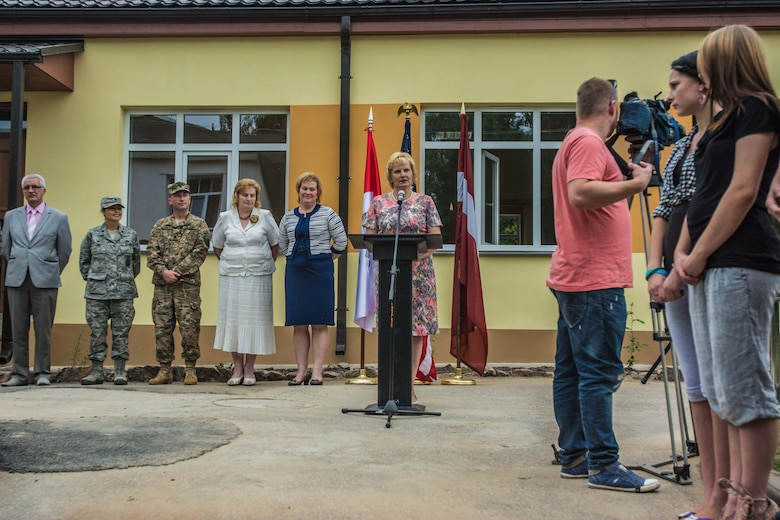 Janina Jalinska, head of Daugavpils Regional Council, speaks during the ribbon-cutting ceremony of a newly reconstructed building of the Naujenu Orphanage near Daugavpils, Latvia, July 23, 2015.  Various U.S. Air National Guard units and Latvian National Armed Forces were participating in the Humanitarian Civic Assistance project through the United States European Command, that pairs units training requirements with humanitarian needs.   (U.S. Air Force photo by Senior Airman Patrick P. Evenson/Released)