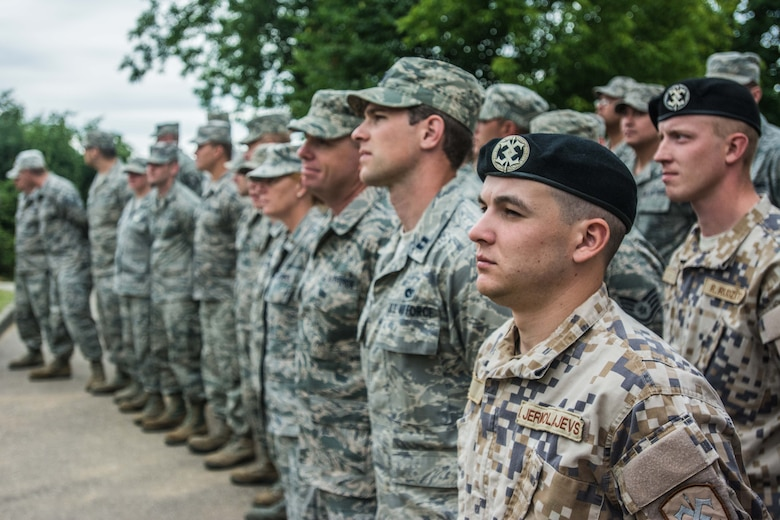 U.S. Airmen with the 139th Civil Engineer Squadron, Missouri Air National Guard, and soldiers with the Latvian National Armed Forces attend the ribbon-cutting ceremony at a newly reconstructed building of the Naujenu Orphanage near Daugavpils, Latvia, July 23, 2015.  The 139th CE was participating in the Humanitarian Civic Assistance project through the United States European Command, that pairs units training requirements with humanitarian needs.   (U.S. Air Force photo by Senior Airman Patrick P. Evenson/Released)