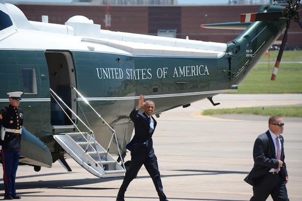 President Barack Obama waves farewell to a small group of media and base personnel at Tinker Air Force Base, Okla. July 16, 2015. Obama and Federal Bureau of Prisons Director Charles E. Samuels, Jr., met with six inmates and staff to discuss sentencing reform at the Federal Correctional Institute El Reno. Reservists, civilians, and active-duty Airmen provided support for the arrival and departure of the president. (U.S. Air Force Photo/ Staff Sgt. Lauren Gleason)