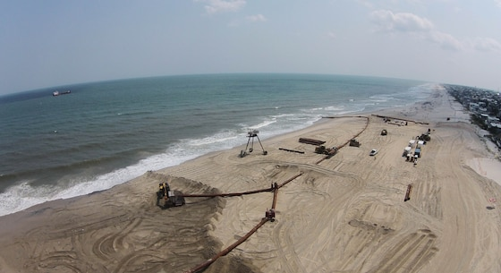 The U.S. Army Corps of Engineers' Philadelphia District and its contractor Great Lakes Dredge & Dock Company are pumping approximately 8 million cubic yards of sand onto Long Beach Island, N.J. The Dredge Dodge Island is shown in the distance. Work is designed to complete the dune and berm system and reduce future storm damages.