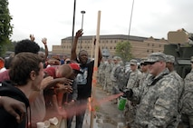 Michigan Army National Guard Soldiers from the Taylor-based 1776th Military Police Company use simulated pepper spray on role players who are posing as riotous victims of a simulated nuclear detonation, during an exercise at Fort Custer Training Center, Augusta, Mich., June 25, 2015. The exercise, Northern Exposure, integrates Michigan National Guard and civilian first responders to rehearse life sustaining capabilities during natural or man-made catastrophic events. (U.S. Air Force photo by Master Sgt. Denice Rankin/released)