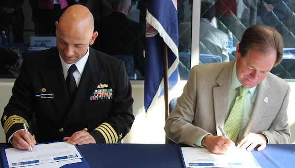 NORFOLK, Va. - Naval Surface Warfare Center Dahlgren Division Commander Capt. Brian Durant and Old Dominion University President Dr. John Broderick sign a memorandum of understanding at ODU Oct. 28. In addition to the memorandum of understanding – which defines the engagement field of a maturing NSWCDD-ODU relationship - they signed education partnership and non-disclosure agreements to expand collaboration benefitting Navy technology programs as well as the university's students and faculty.