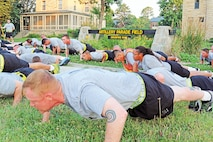 """""""Dagger"""" brigade Soldiers do pushups June 30 after learning about the his¬tory of Fort Riley's Artillery Parade Field. Soldiers each completed 17 pushups to signify the 1st Bn., 7th Field Artillery Regt., 2nd ABCT, 1st Inf. Div."""