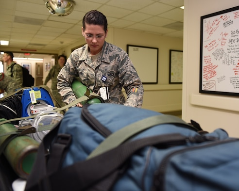 Airman 1st Class Megan Pollard prepares supplies for an incoming aeromedical evacuation flight at the Wilford Hall Ambulatory Surgical Center, Joint Base San Antonio-Lackland, Texas, July 23, 2015. Pollard is part of a 12-person team assigned to the 559th En-Route Patient Staging System that serves as the Midwest aeromedical evacuation hub for wounded warriors transiting back home or here for specialty care. (U.S. Air Force photo by Staff Sgt. Jerilyn Quintanilla)