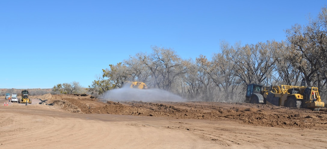 SOCORRO, N.M. -- The contractor works on the San Acacia Levee along the Rio Grande, Feb. 25, 2015.