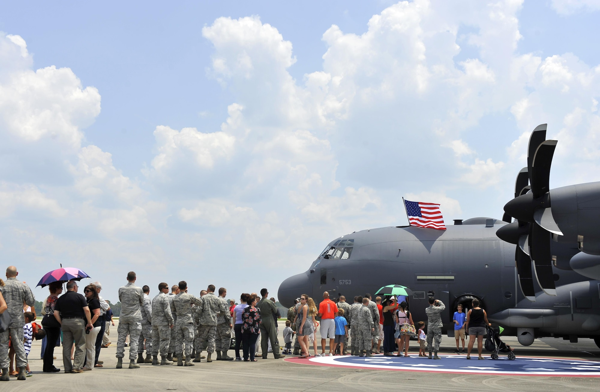 A crowd gathers to view the inside of the Air Force Special Operations Command's first AC-130J Ghostrider at Hurlburt Field, Fla., July 29, 2015. The aircrews of the 1st Special Operations Group Detachment 2 were hand selected from the AC-130 community for their operational expertise and will begin initial operational testing and evaluation of the AC-130J later this year. (U.S. Air Force photo by Airman Kai White/Released)