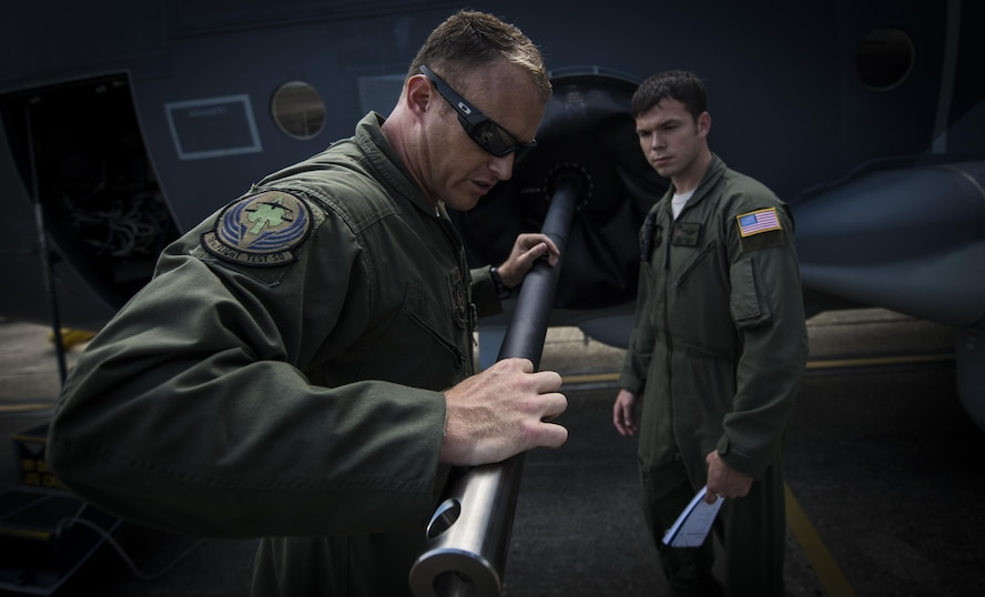 Master Sgt. James Knight left, 18th Flight Test Squadron aerial gunner, performs a pre-flight inspection with Staff Sgt. Rob Turner right, 1st Special Operations Group Detachment 2 aerial gunner, on Eglin Air Force Base, Fla., July 29, 2015. The aircrews of the 1st SOG Det. 2 were hand selected from the AC-130 community for their operational expertise and will begin initial operational testing and evaluation of the AC-130J later this year. (U.S. Air Force photo/Senior Airman Christopher Callaway)