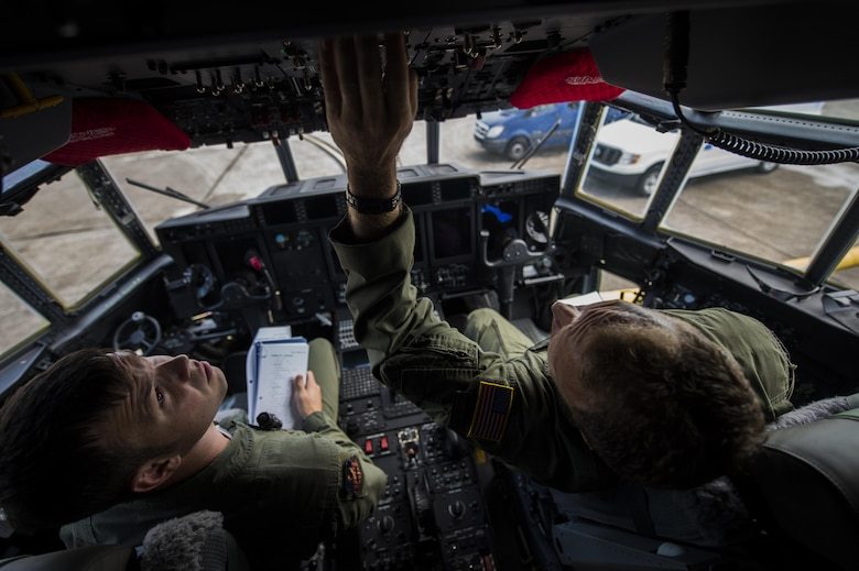 Master Sgt. James Knight right, 18th Flight Test Squadron aerial gunner, instructs Staff Sgt. Rob Turner left, 1st Special Operations Group Detachment 2 aerial gunner, on new changes regarding pre-flight inspections in an AC-130J Ghostrider on Eglin Air Force Base, Fla., July 29, 2015. The aircrews of the 1st SOG Det. 2 were hand selected from the AC-130 community for their operational expertise and will begin initial operational testing and evaluation of the AC-130J later this year. (U.S. Air Force photo/Senior Airman Christopher Callaway)