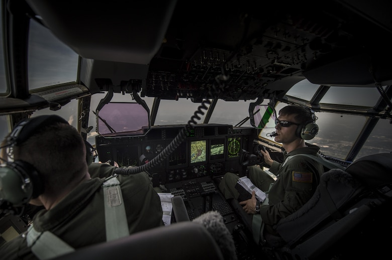 Maj. Brian Pesta right, 1st Special Operations Group Detachment 2 pilot (right) and Maj. Jason Fox left, 18th Flight Test Squadron pilot, look out the left window during the delivery flight of Air Force Special Operations Command's first AC-130J Ghostrider to the 1st Special Operations Wing on Hurlburt Field, Fla., July 29, 2015. The AC-130J recently completed its initial developmental test and evaluation at Eglin Air Force Base, Fla., and will begin initial operational test and evaluation under aircrews of the 1st SOG Det. 2 and 1st Special Operations Aircraft Maintenance Squadron later this year. (U.S. Air Force photo/Senior Airman Christopher Callaway)