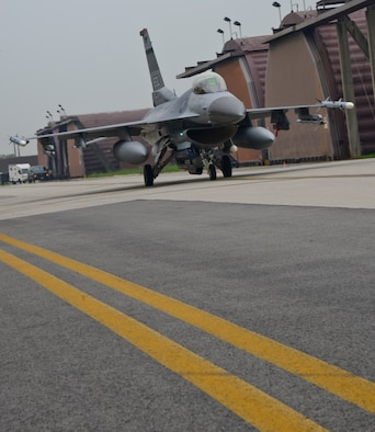 "A 36th Fighter Squadron F-16C ""Fighting Falcon"", prepares to launch on Osan Air Base, South Korea, July 22, 2015. The 36th FS has a 90-year history in the Air Force, where they flew 21 different types of aircraft, received 22 unit citations, and accumulated 24 service and campaign streamers since World War I. (U.S. Air Force photo/Senior Airman Kristin High/Released)"