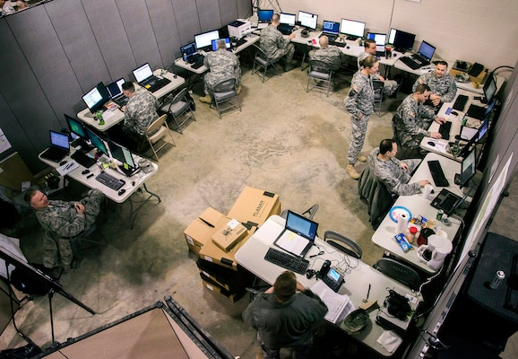 Members of the Ohio National Guard Computer Network Defense Team conduct cyberdefense operations during exercise Cyber Shield 2015 at Camp Atterbury, Ind., March 20. The exercise was designed to develop the defensive skills of soldiers and airmen tasked with securing their organizations' computer networks. U.S. Army National Guard photo by Staff Sgt. George Davis