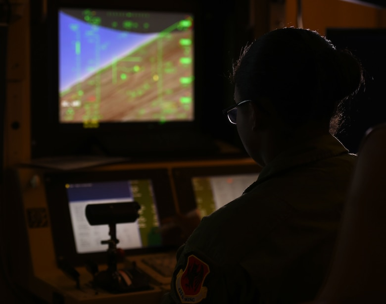 Senior Airman Shantae, 11th Reconnaissance Squadron sensor operator, flies a simulated mission as part of her launch and recovery training, June 22, 2015 at Creech Air Force Base, Nevada. On July 29, 1995, the 11th RS was activated at the then Indian Springs Air Force Auxiliary Field, Nevada, as the Air Force's first dedicated remotely piloted aircraft unit when it assumed operational control of RQ-1 Predator aircraft. Today, the 11th RS celebrated the 20th anniversary of its activation.  (U.S. Air Force photo by Tech. Sgt. Nadine Barclay)