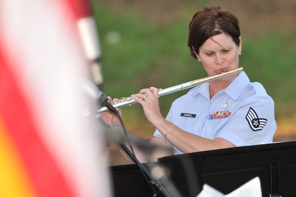 "Staff Sgt. Kristi Hammiel, a musician with the Air National Guard Band of the Midwest based in Peoria, Ill plays the flute during a concert in Sioux City, Iowa on July 27, 2015. The 566th Air Force Band is performing in Sioux City as part of their summer concert series entitled ""Hero's Among Us"". As part of their two week annual training this year, the band is performing primarily in Iowa and South Dakota.