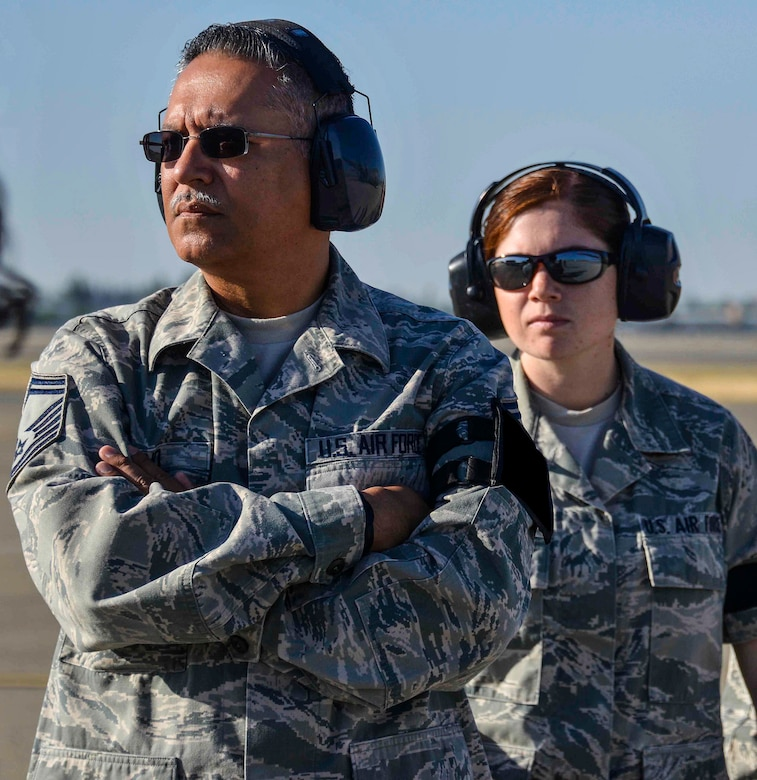 U.S. Air Force Senior Master Sgt. Arturo Cano, 144th Logistics Readiness Squadron logistics plans superintendent, and U.S. Air Force Staff Sgt. Micaelah Aleman, 144th LRS logistics plans NCO in charge, are two out of many Air Guardsmen behind the scenes who contribute to the mission's success at the Fresno Air National Guard base. (Air National Guard photo by Senior Airman Klynne Pearl Serrano/Released)