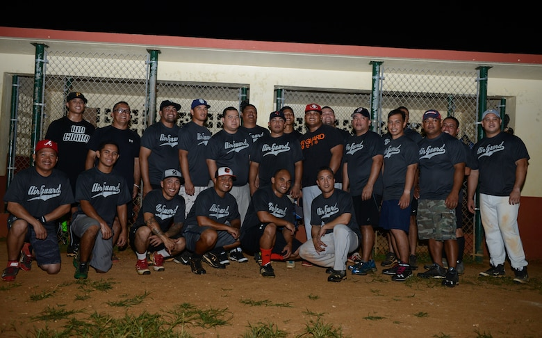 The 254th Air National Guard stands for a team photo at the end of the intramural softball game between the 36th Civil Engineer Squadron and Guam ANG July 28, 2015, at Andersen Air Force Base, Guam. The GU ANG won the game with a score of 16-12. (U.S. Air Force photo by Airman 1st Class Arielle Vasquez/Released)