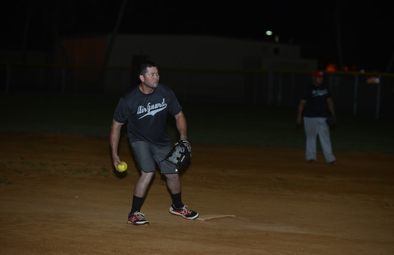 Cliff Raphael, Guam Air National Guard, gets ready to pitch to a batter during the intramural softball championship game between the 36th Civil Engineering Squadron and GU ANG July 28, 2015, at Andersen Air Force Base, Guam. The GU ANG won the game with a score of 16-12. (U.S. Air Force photo by Airman 1st Class Arielle Vasquez/Released)