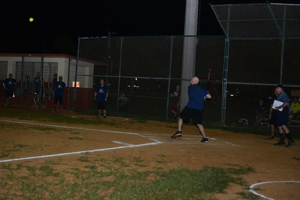 Donald McNair, 36th Civil Engineer Squadron, prepares to hit the ball during the intramural softball championship game between the 36th CES and Guam Air National Guard July 28, 2015, at Andersen Air Force Base, Guam. The GU ANG won the game with a score of 16-12. (U.S. Air Force photo by Airman 1st Class Arielle Vasquez/Released)