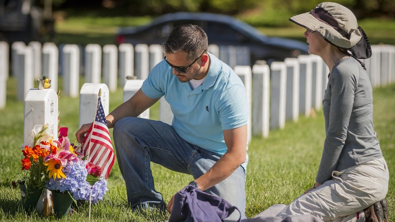 Alison Malachowski tends to the grave of her son, U.S. Marine Corps Staff Sgt. James Malachowski, with former Marine Sgt. Danny Gonzalez - who served in the Marine Corps Rifle Team with and was best friends with James until his death - in Section 60 of Arlington National Cemetery, July 22, 2015. The two have remained close since James was killed by an improvised explosive device while on his fourth combat deployment in Afghanistan in 2011. Staff Sgt. Malachowski - who was by all accounts a superior Marine on the fast track to the upper-echelons of military service - was with the 2nd Battalion of the 8th Marines when he was killed on March 20, 2011, while his unit was raising the Afghanistan national flag over a small compound near Patrol Base Dakota in Marjah Province. (U.S. Army photo by Sgt. Ken Scar)