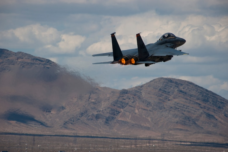 "An F-15E Strike Eagle assigned to the 389th Fighter Squadron takes off during Red Flag 15-3 at Nellis Air Force Base, Nev., July 21, 2015. Aircraft and personnel deploy to Nellis AFB for Red Flag under the air expeditionary force concept and make up the exercise's ""blue"" forces. By working together, these blue forces are able to utilize the diverse capabilities of their aircraft to execute specific missions, such as air interdiction, combat search and rescue, close air support, dynamic targeting, and defensive counter air. The 389th FS is from Mountain Home AFB, Idaho. (U.S. Air Force photo/Senior Airman Thomas Spangler)"