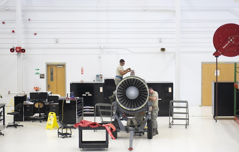 Members of the 23rd Component Maintenance Squadron Propulsion Flight perform maintenance on a TF-34 engine July 27, 2015, at Moody Air Force Base, Ga. The 23rd CMS supplies the 74th and 75th Fighter Squadrons with TF-34s in support of Moody AFB's A-10C Thunderbolt IIs. (U.S. Air Force photo/Airman Greg Nash)