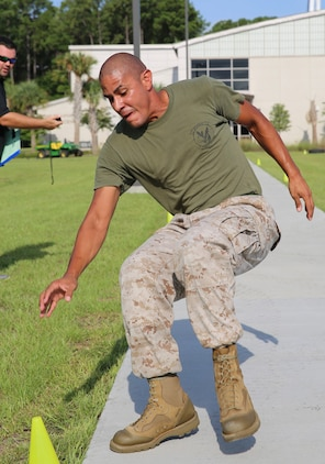 Sgt. Osias Lozano executes a cone drill during the Tactical Athlete Challenge held aboard Marine Corps Air Station Beaufort July 29. Marines from MCAS Beaufort competed in challenges based on the rigorous fundamentals of the High Intensity Tactical Training program. Lozano is a training non-commissioned officer with Marine Aviation Logistics Squadron 31.