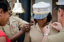 U.S. Marine Corps Maj. Lisa Lawrence is promoted to her present rank at Marine Barracks Washington, D.C., June 6, 2015. Lawrence, a native of Houston, has served in the Marine Corps for 11 years as a public affairs officer, completing combat tours in both Iraq and Afghanistan. She currently serves as an officer selection officer for Recruiting Station Baltimore, where she is tasked with recruiting highly qualified men and women who desire to become Marine officers. (U.S. Marine Corps photo by Sgt. Bryan Nygaard/Released)