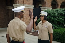 U.S. Marine Corps Maj. Lisa Lawrence recites the Uniformed Services Oath of Office during her promotion ceremony at Marine Barracks Washington, D.C., June 6, 2015. Lawrence, a native of Houston, has served in the Marine Corps for 11 years as a public affairs officer, completing combat tours in both Iraq and Afghanistan. She currently serves as an officer selection officer for Recruiting Station Baltimore, where she is tasked with recruiting highly qualified men and women who desire to become Marine officers. (U.S. Marine Corps photo by Sgt. Bryan Nygaard/Released)