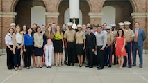 U.S. Marine Corps Maj. Lisa Lawrence poses with friends, fellow Marines, and Marine officer candidates during her promotion ceremony at Marine Barracks Washington, D.C., June 6, 2015. Lawrence, a native of Houston, has served in the Marine Corps for 11 years as a public affairs officer, completing combat tours in both Iraq and Afghanistan. She currently serves as an officer selection officer for Recruiting Station Baltimore, where she is tasked with recruiting highly qualified men and women who desire to become Marine officers. (U.S. Marine Corps photo by Sgt. Bryan Nygaard/Released)