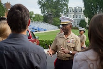 U.S. Marine Corps Lieutenant Gen. Ronald L. Bailey, the Deputy Commandant for Plans, Policies and Operations for the Marine Corps, compliments Maj. Lisa Lawrence's character and experience during her promotion ceremony at Marine Barracks Washington, D.C., June 6, 2015. Lawrence, a native of Houston, has served in the Marine Corps for 11 years as a public affairs officer, completing combat tours in both Iraq and Afghanistan. She currently serves as an officer selection officer for Recruiting Station Baltimore, where she is tasked with recruiting highly qualified men and women who desire to become Marine officers. (U.S. Marine Corps photo by Sgt. Bryan Nygaard/Released)