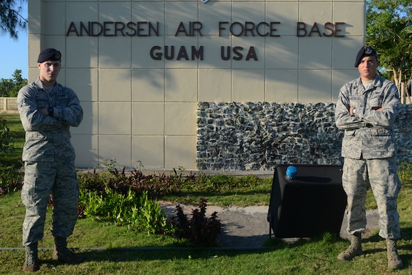 U.S. Air Force Airmen 1st Class Colby (left) and Travis Wakefield, 36th Security Forces Squadron entry controllers, stand at the entry to Andersen Air Force Base, Guam, July 29, 2015. While they are brothers in arms who serve together, they are also fraternal twins who have worked together since entering the Air Force in October 2013. (U.S. Air Force photo by Airman 1st Class Alexa Ann Henderson/Released)