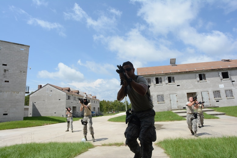 Members of the 125th Fighter Wing Security Forces Squadron conduct deployment training on July 24, 2015 at Camp Blanding Joint Training Center, Starke, Florida. Instructors from the Florida National Guard Counter Drug program helped train the Airmen in urban close quarters battle operations. (U.S. Air Force photo by MSgt Jaclyn Lyons)