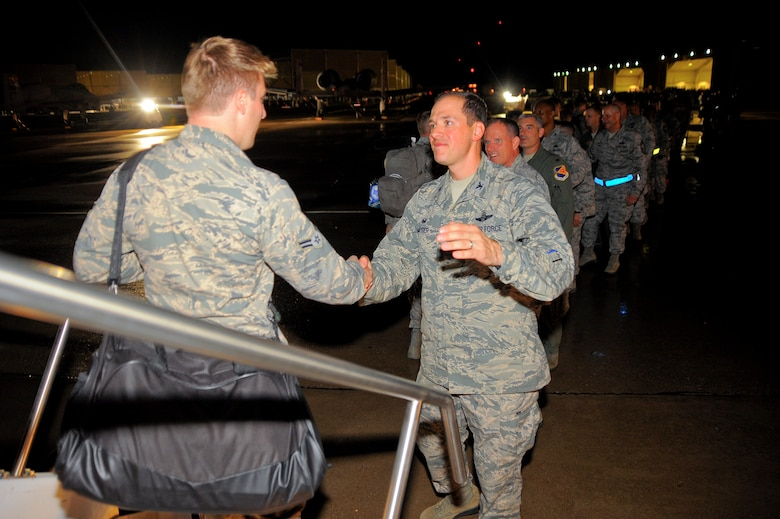 U.S. Air Force Col. James P. Meger, 355th Fighter Wing commander, leads the welcome line of the 355th Fighter Wing leaders at Davis-Monthan Air Force Base, Ariz., July 29, 2015, greeting more than 200 Airmen as they return home from six month deployment to Europe.  The Airmen were deployed in support of the first European Theater Security Package in support of Operation Atlantic Resolve. (U.S. Air Force photo by Staff Sgt. Angela Ruiz/Released)