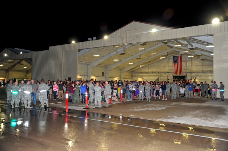 Family, friends and 355th Fighter Wing senior leaders wait on the flightline at Davis-Monthan Air Force Base, Ariz., July 29, 2015, to welcome home Airmen from a six month deployment to Europe. This is D-M's largest deployment with 1,200 Airmen across D-M having deployed around the world. (U.S. Air Force photo by Senior Airman Chris Massey/Released)