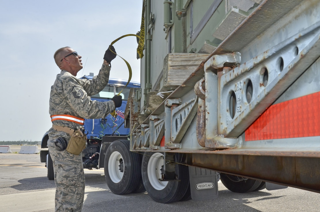 Master Sgt. George Peoples, 117th Air Refueling Wing unstraps cargo containers after arriving in Gulfport, Mississippi during a training exercise June 22 2015. (U.S. Air National Guard Photo By: Senior Master Sgt. Ken Johnson/Released)