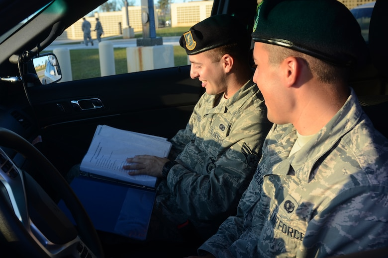Airmen 1st Class Travis (left) and Colby Wakefield, 36th Security Forces Squadron entry controllers, prepare for a shift together July 29, 2015, at Andersen Air Force Base, Guam. While they are brothers in arms who serve together, they are also fraternal twins who have worked together since entering the Air Force in October 2013. (U.S. Air Force photo by Airman 1st Class Alexa Ann Henderson/Released)