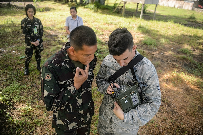 U.S. Air Force Senior Airman Jason Heinl, right, explains a communication device to a Philippine service member during Pacific Partnership 2015 in Capiz, Philippines, July 29, 2015. Pacific Partnership, in its tenth iteration, is the largest annual multilateral humanitarian assistance and disaster relief preparedness mission conducted in the Indo-Asia-Pacific region.