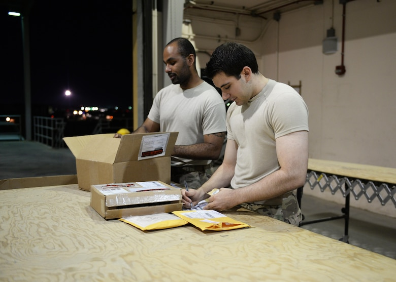 U.S. Airmen from the 455th Expeditionary Logistics Readiness Squadron's Traffic Management Office sort and label materials July 21, 2015, at Bagram Airfield, Afghanistan. The team is responsible for ensuring all shipments from the AOR, to include hazardous and classified materials as well as aircraft parts, are ready for transport. (U.S. Air Force photo by Senior Airman Cierra Presentado/Released)