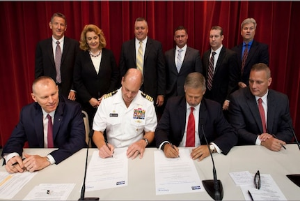 Naval Surface Warfare Center Indian Head Explosive Ordnance Disposal Technology Division (NSWC IHEODTD) Commanding Officer, Capt. Vincent Martinez (center left); Technical Director, Ashley Johnson (far left); Chemring North America President, Juan Navarro (center right); and Chemring Ordnance President Mike Quesenberry (far right) - joined by team leads from both organizations - sign certificates commemorating the command's first public-private partnership under the CITE designation.